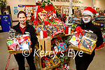 Sabrina Murphy and Sharon Boyle display the Christmas hampers in Garvey's Listowel.