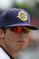 A close up shot of Ray Kruml of the Charleston RiverDogs from the dugout during a game against the Rome Braves on April 27, 2010 in Charleston, SC.