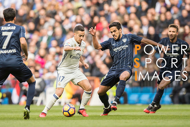 Lucas Vazquez of Real Madrid battles for the ball with Jose Luis Garcia del Pozo, Recio, of Malaga CF during their La Liga 2016-17 match between Real Madrid and Malaga CF at the Estadio Santiago Bernabéu on 21 January 2017 in Madrid, Spain. Photo by Diego Gonzalez Souto / Power Sport Images