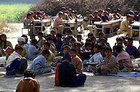 Children at school in Noranga. Most of the 120 children must sit on the ground. Only a few have the chance to sit on a table.<br /> 17.2.2001, Noranga/Punjab<br /> Copyright: Christian-Ditsch.de<br /> [Inhaltsveraendernde Manipulation des Fotos nur nach ausdruecklicher Genehmigung des Fotografen. Vereinbarungen ueber Abtretung von Persoenlichkeitsrechten/Model Release der abgebildeten Person/Personen liegen nicht vor. NO MODEL RELEASE! Nur fuer Redaktionelle Zwecke. Don't publish without copyright Christian-Ditsch.de, Veroeffentlichung nur mit Fotografennennung, sowie gegen Honorar, MwSt. und Beleg. Konto: I N G - D i B a, IBAN DE58500105175400192269, BIC INGDDEFFXXX, Kontakt: post@christian-ditsch.de<br /> Bei der Bearbeitung der Dateiinformationen darf die Urheberkennzeichnung in den EXIF- und  IPTC-Daten nicht entfernt werden, diese sind in digitalen Medien nach §95c UrhG rechtlich geschuetzt. Der Urhebervermerk wird gemaess §13 UrhG verlangt.]