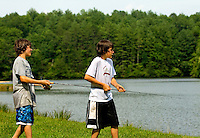Boy Scouts try their hand at fishing while attending Boy Scout resident camp in summer 2010 at Camp Raven Knob. Camp Raven Knob Scout Reservation, one of the largest Boy Scout camps in the United States, is located within Boy Scouts of America's Old Hickory Council in Mt. Airy, North Carolina. Troops from across the US attend the camp's one-week residential boys' summer programs, which offer instruction on more than 40 merit badges, adventure programs and new Scout orientation.