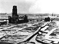 The German ultimatum ordering the Dutch commander of Rotterdam to cease fire was delivered to him at 10:30 a.m. on May 14, 1940.  At 1:22 p.m., German bombers set the whole inner city of Rotterdam ablaze, killing 30,000 of its inhabitants.  (OWI)<br /> NARA FILE #:  208-PR-10L-3<br /> WAR & CONFLICT BOOK #:  1334