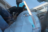 """CAMPINAS, SP 11.04.2018-OPERACAO VIDOCQ-Um dos presos com roupa da Policia Militar Rodoviaria. Na manhã desta quarta-feira (11), o Gaeco, em conjunto com o 1 BAEP, com a Corregedoria da Polícia Civil e com a Corregedoria da Polícia Militar da cidade de Campinas (SP), deflagrou a operação """"Vidocq"""", que visa desmantelar organização criminosa voltada à prática dos crimes de roubo circunstanciado e furto qualificado de cargas na região de Campinas. Para tanto, foram cumpridos dezessete mandados de prisão temporária, além de vinte e dois mandados de busca e apreensão e mais dezessete mandados de apreensão de veículos, nas cidades de Campinas, Paulinia, Sumaré, Nova Odessa, Cosmópolis, Hortolandia e Artur Nogueira. O grupo criminoso tinha como uma das marcas características, em alguns dos crimes, simular a condição de Policial Militar, inclusive com a utilização de fardas, para facilitar a abordagem aos caminhões e veículos que transportavam as cargas de interesse. O prazo da prisão é de cinco dias, prorrogável por igual período. Dentre os alvos da operação encontram-se dois Policiais Militares, um Policial Civil e um Guarda Municipal, cuja participação na organização criminosa também é alvo de investigação. (Foto: Denny Cesare/Codigo19)"""