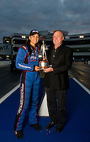 Sept. 18, 2011; Concord, NC, USA: NHRA pro mod driver Leah Pruett (left) poses for a portrait with team owner Roger Burgess after winning the O'Reilly Auto Parts Nationals at zMax Dragway. Mandatory Credit: Mark J. Rebilas-