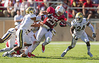 STANFORD, CA - October 19, 2013:  Stanford Cardinal running back Tyler Gaffney (25) fights for yardage during the Stanford Cardinal vs the UCLA Bruins at Stanford Stadium in Stanford, CA. Final score Stanford Cardinal 24, UCLA Bruins  10.
