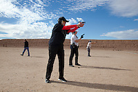 USA. Arizona state. Phoenix. Ben Avery Shooting Facility. The Ben Avery Shooting Facility, formerly the Black Canyon Shooting Range, is one of the largest publicly operated shooting facilities in the United States. Melodie Anne Coffman (C) is shooting with a group of women, all with handguns in ahnds. They are training their skills.  Melodie Anne Coffman is a NRA ( National Rifle Association) certified instructor in Basic Pistol and defense courses. A firearm is a portable gun, being a barreled weapon that launches one or more projectiles often driven by the action of an explosive force. Most modern firearms have rifled barrels to impart spin to the projectile for improved flight stability. The word firearms usually is used in a sense restricted to small arms (weapons that can be carried by a single person). The right to keep and bear arms is a fundamental right protected in the United States by the Second Amendment of the Bill of Rights in the Constitution of the United States of America and in the state constitutions of Arizona and 43 other states. 31.01.16 © 2016 Didier Ruef