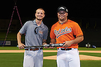 Peoria Javelinas D.J. Stewart (15), of the Baltimore Orioles organization, is presented with the American League second place trophy bat from Zinger by Josh Michalsen during the Bowman Hitting Challenge on October 8, 2016 at the Salt River Fields at Talking Stick in Scottsdale, Arizona.  (Mike Janes/Four Seam Images)