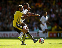 Wayne Routledge of Swansea battles with Valon Behrami of Watford   during the Barclays Premier League match Watford and Swansea   played at Vicarage Road Stadium , Watford