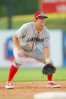 Third baseman Adam Buschini #26 of the Lakewood BlueClaws on defense against the Kannapolis Intimidators at Fieldcrest Cannon Stadium July 14, 2010, in Kannapolis, North Carolina.  Photo by Brian Westerholt / Four Seam Images