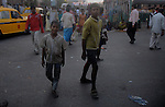 Alamgir and one of his mate roaming around near Sealdah station the place where he lives. He is staying here for last 6 years from the time he ran away from his home due to domestic violence and poverty. As per his version his father was a drunkard and used to beat his mother for no reason. His father even could not earn enough money to buy food for their big family. Due to this traumatic situation he ran away from house at the age of seven. Ever since, the Sealdah railway station in Kolkata has been his home. As far as company is concerned, he had not much reason to miss his family. There are around 500 children, from 5 to 16 years, who live in the premises of Kolkata's second largest train terminus. Most of them addicted to Brown Sugar and sniffing industrial adhesive Dendrite. They say they don't feel hungry if they take the drugs. Their presence is conspicuous, even in a place that registers an average footfall of 1.4 million on weekdays. Their activities cover a wide range, from begging, to pulling handcarts, to petty theft, to selling odds and ends on the platform or on trains. The money, earned or ill-gotten as the case may be, is spent in procuring heroin, brown sugar, cocaine, and tubes of Dendrite. Calcutta, West Bengal, India. Arindam Mukherjee