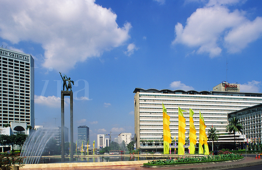 Indonesia. Jakarta. The Welcome Monument at the commercial heart of the city and at the main intersection of Jalan M. H. Thamrin and Jalan Jendral Sudirman, surrounded by some of the city's major hotels..