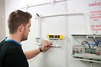 Student electrician installing a domestic socket, Able Skills, Dartford, Kent.