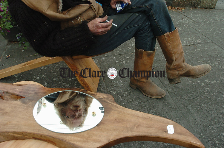 Dell Harding of Tuamgraney partly reflected in some of his woodcraft on display  in the market square as part of the Scariff Harbour Festival. Photograph by John Kelly.
