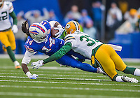 14 December 2014: Buffalo Bills wide receiver Sammy Watkins is tackled after receiving a pass for a 28-yard gain in the second quarter against the Green Bay Packers at Ralph Wilson Stadium in Orchard Park, NY. The Bills defeated the Packers 21-13, snapping the Packers' 5-game winning streak and keeping the Bills' 2014 playoff hopes alive. Mandatory Credit: Ed Wolfstein Photo *** RAW (NEF) Image File Available ***