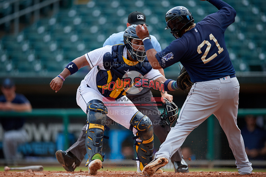 Montgomery Biscuits catcher David Rodriguez (12) tags Roberto Pena (21) out at home during a Southern League game against the Mobile BayBears on May 2, 2019 at Riverwalk Stadium in Montgomery, Alabama.  Mobile defeated Montgomery 3-1.  (Mike Janes/Four Seam Images)