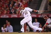 ANAHEIM - OCTOBER 9:  Juan Rivera of the Los Angeles Angels of Anaheim bats against the Boston Red Sox during Game 2 of the American League Division Series at Angel Stadium on October 9, 2009 in Anaheim, California. Photo by Brad Mangin