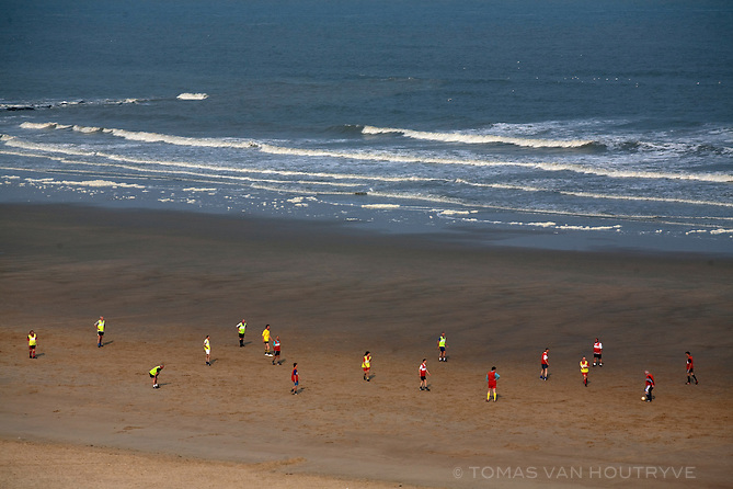 Teams play football (soccer) on the beach in Ostende, Belgium on April 29, 2007.
