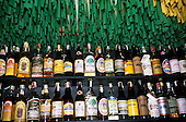 Rio de Janeiro, Brazil. Collection of cachaca (sugar cane alcohol) bottles on display; bar Academia da Cachaca, Leblon.