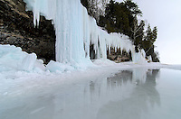 Reflections of the Grand Island ice caves during the later winter on a warm day. Munising, MI