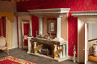 BNPS.co.uk (01202) 558833<br /> Pic:  ZacharyCulpin/BNPS<br /> <br /> The detail of the fire place is incredible<br /> <br /> A model maker who spent 25 years building a stunning miniature Georgian mansion has put it up for sale for £8,750.<br /> <br /> Len Martin spared no expense or time in creating the incredibly ornate model home that includes Swarovski chandeliers, gold furniture and artwork from Egyptian King Farouk's artist.<br /> <br /> The 42ins tall property also boasts a sweeping driveway, 16 statues, 138 balustrades, marble floors, stone cherubs on the ceilings and more tiny oil paintings crafted by real artists.