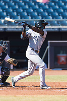 Glendale Desert Dogs left fielder Estevan Florial (13), of the New York Yankees organization, follows through on his swing during an Arizona Fall League game against the Peoria Javelinas at Peoria Sports Complex on October 22, 2018 in Peoria, Arizona. Glendale defeated Peoria 6-2. (Zachary Lucy/Four Seam Images)