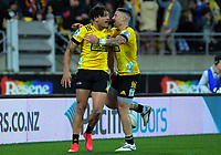 Hurricanes TJ Perenara congratulates Billy Proctor on his try during the Super Rugby Aotearoa match between the Hurricanes and Chiefs at Sky Stadium in Wellington, New Zealand on Saturday, 8 August 2020. Photo: Dave Lintott / lintottphoto.co.nz