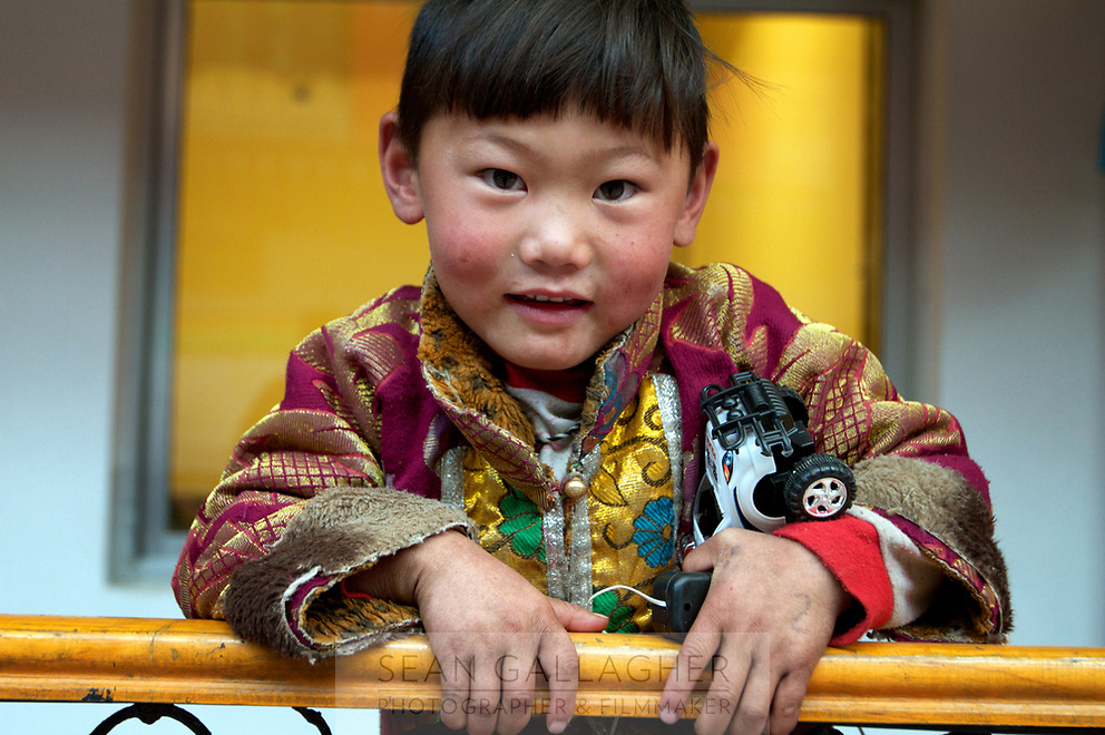 A young Tibetan boy at Labrang (Chinese Name - Xiahe) Monastery on the Qinghai-Tibetan Plateau. China.