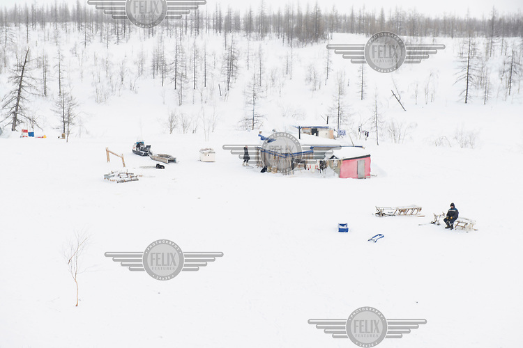 The remote camp of a group of Evenk reindeer herders in the Siberian tundra.
