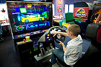 Boy playing an arcade video game.