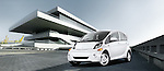 One white 2012 Mitsubishi MiEV SE outdoors near modern architechture.