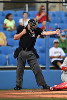 Home plate umpire Kirk Struble makes a call during a game between the Clearwater Threshers and Dunedin Blue Jays on April 10, 2015 at Florida Auto Exchange Stadium in Dunedin, Florida.  Clearwater defeated Dunedin 2-0.  (Mike Janes/Four Seam Images)