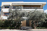 facade of the house..Due to his love of the sea, Mr Koutsikos moved from the centor of Athens to the seaside suburb of Voula in Athens, Greece. The old three-storey cottage-type building was recreated by him in collaboration with his partner, the architect Fafalios Stamos.
