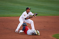 Rochester Red Wings second baseman Jorge Polanco (11) awaits a throw as Collin Cowgill (7) dives back to the bag during a game against the Columbus Clippers on June 14, 2016 at Frontier Field in Rochester, New York.  Rochester defeated Columbus 1-0.  (Mike Janes/Four Seam Images)