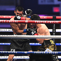 ARLINGTON, TX - DECEMBER 5: Juan Tapia and Fernando Garcia during their fight on Fox Sports PBC Pay-Per-View fight night at AT&T Stadium in Arlington, Texas on December 5, 2020. (Photo by Frank Micelotta/Fox Sports)