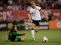 Alex Morgan (13) of the USWNT springs past Thais (12) of Brazil in the box during an international friendly at the Florida Citrus Bowl in Orlando, FL.  The USWNT defeated Brazil, 4-1.