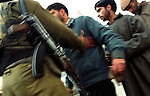 A bsf (border security force) personnel checks body of locals at a check point at Lal chowk. Srinagar, Jammu and Kashmir, India, Arindam Mukherjee