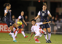 BOCA RATON, FL - DECEMBER 15, 2012: Carli Lloyd (10) and Lauren Cheney (12) of the USA WNT win the ball from Wang Chen (16) of China WNT during an international friendly match at FAU Stadium, in Boca Raton, Florida, on Saturday, December 15, 2012. USA won 4-1.
