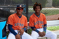 GCL Astros Gerry Castillo (30) and Freudis Nova (16) in the dugout during a game against the GCL Nationals on August 6, 2018 at FITTEAM Ballpark of the Palm Beaches in West Palm Beach, Florida.  GCL Astros defeated GCL Nationals 3-0.  (Mike Janes/Four Seam Images)