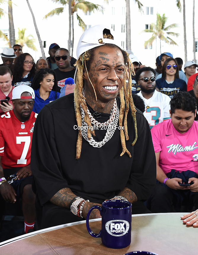 "MIAMI BEACH, FL - JANUARY 31: Lil Wayne on the set of ""Skip & Shannon: Undisputed"" on the Fox Sports South Beach studio during Super Bowl LIV week on January 31, 2020 in Miami Beach, Florida. (Photo by Frank Micelotta/Fox Sports/PictureGroup)"
