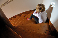 Girl (8) sitting in staircase corner, pouting (Licence this image exclusively with Getty: http://www.gettyimages.com/detail/84869063 )