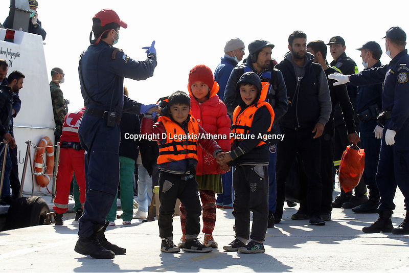 Pictured: Young children with life vests disembark in Ierapetra Thursday 27 November 2014<br /> Re: One of the largest refugee boats in recent months has disembarked refugees in Ierapetra, Crete. The freighter Baris, carrying 700 people thought to be from Syria and Afghanistan, is being towed by a Greek frigate.<br /> Officials and Red Cross volunteers prepared an indoor basketball stadium as interim shelter in the southern Cretan port town of Ierapetra on Wednesday ahead of the migrants' expected arrival.<br /> Greek officials said the Baris, which lost propulsion on Tuesday, was being towed slowly in poor sea conditions and would arrive after nightfall, probably early Thursday.<br /> They said it was unclear which Mediterranean location had been the departure point for the 77-meter (254-foot) vessel, which was sailing under the flag of the Pacific nation of Kiribati.