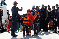 Pictured: Young children with life vests disembark in Ierapetra Thursday 27 November 2014<br />