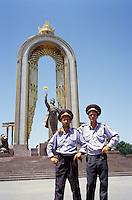 Two policemen next to the monument of King Ismaili Somoni in the Tadzhik capital Dushanbe