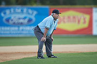 Umpire Gerald Trexler handles the calls on the bases during the Coastal Plain League game between the Martinsville Mustangs and the High Point-Thomasville HiToms at Finch Field on July 26, 2020 in Thomasville, NC.  The HiToms defeated the Mustangs 8-5. (Brian Westerholt/Four Seam Images)