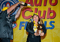 Nov 17, 2019; Pomona, CA, USA; NHRA pro stock motorcycle rider Jianna Salinas is doused with champagne as she celebrates with crew after winning the Auto Club Finals at Auto Club Raceway at Pomona. Mandatory Credit: Mark J. Rebilas-USA TODAY Sports