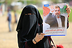 Palestinian militants from the Al-Quds Brigades, the armed wing of the Islamic Jihad movement, take part in a symbolic funeral for the movement's former leader Ramadan Shalah in Gaza city, on June 7, 2020. Ramadan Abdullah Shalah, the former secretary-general of the Palestinian Islamic Jihad Movement, died at the age of 62 after a long illness. Shalah was the secretary-general of the Palestinian Islamic Jihad between 27 October 1995 and 2018. Photo by Ashraf Amra