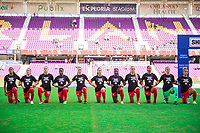 ORLANDO, FL - FEBRUARY 24: CANWNT kneels for the national anthem before a game between Brazil and Canada at Exploria Stadium on February 24, 2021 in Orlando, Florida.