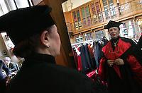 Un magistrato donna indossa la toga nella sala della vestizione.A woman magistrate wearing the gown in the dressing room.Roma 29/01/2010 Inaugurazione dell'Anno Giudiziario alla Corte di Cassazione..Opening of the Judicial Year..Photo Samantha Zucchi Insidefoto
