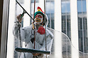 Window cleaners clad in animal costumes from Chinese zodiac at work