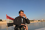BAGHDAD, IRAQ: Coach Majid Salih watches the team practice on the Tigris river..Iraq is fielding a rowing team for the London 2012 Olympics...Photo by Kamaran Najm/Metrography